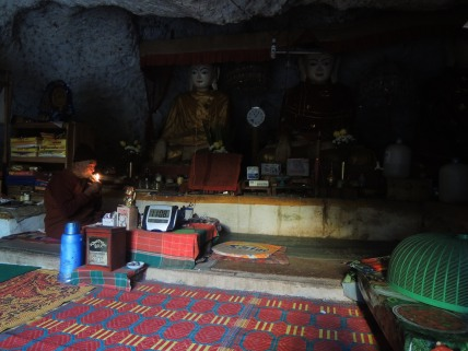 Elderly monk sitting in his cave home